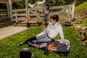 Enjoying my picnic on a Fior Da Liso dressage pad while Clooney basks in the sun behind me. (Photo by Lisa Hawkins).